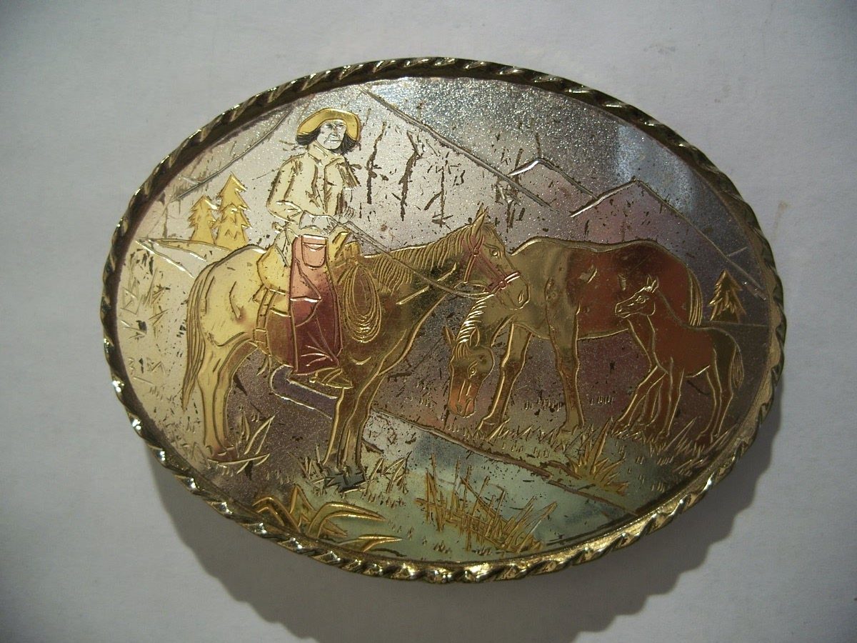 Western Cowboy on a Horse in Mountains Belt Buckle