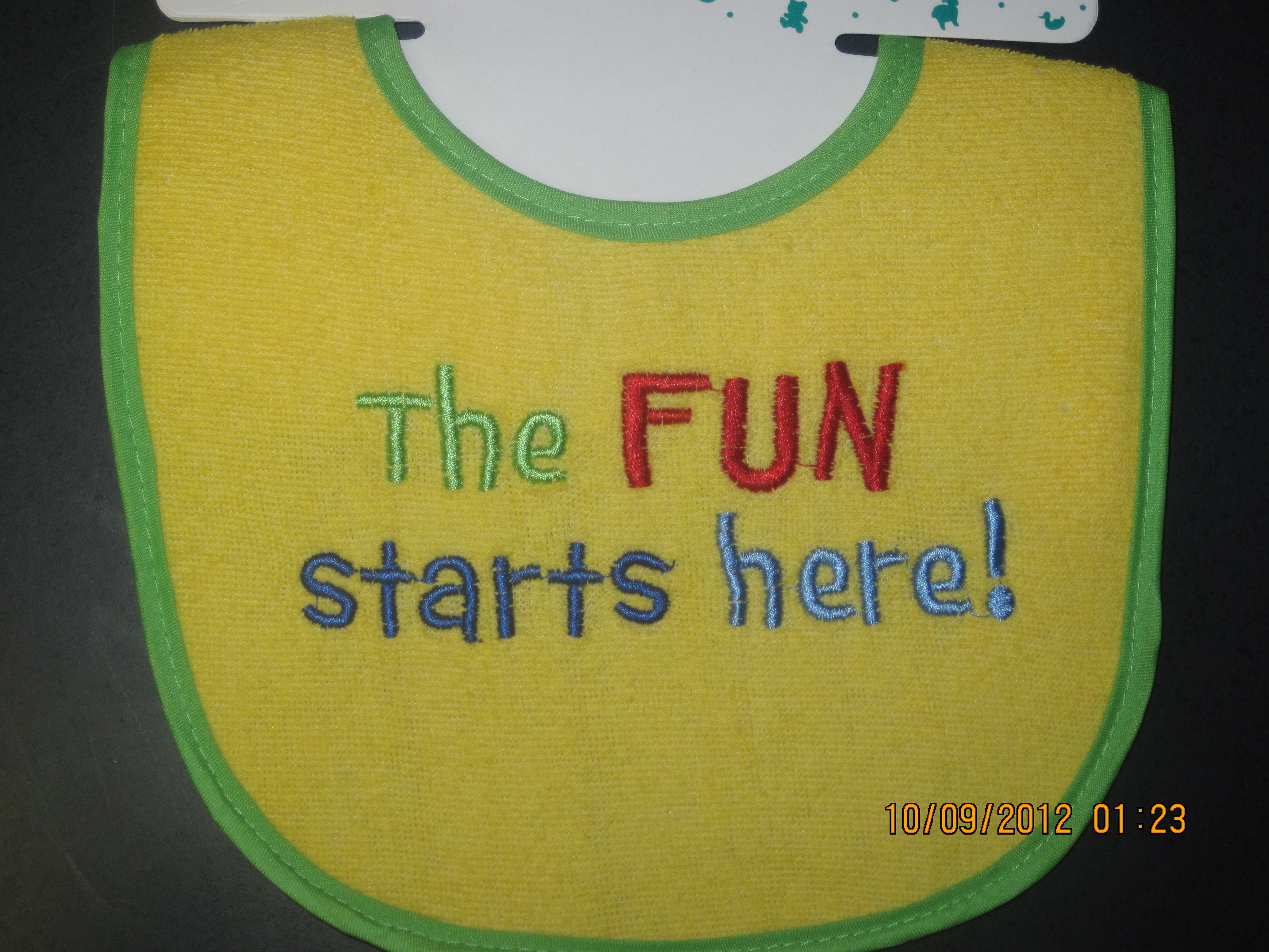 The Fun Starts Here Infant Bib (yellow with green trim)