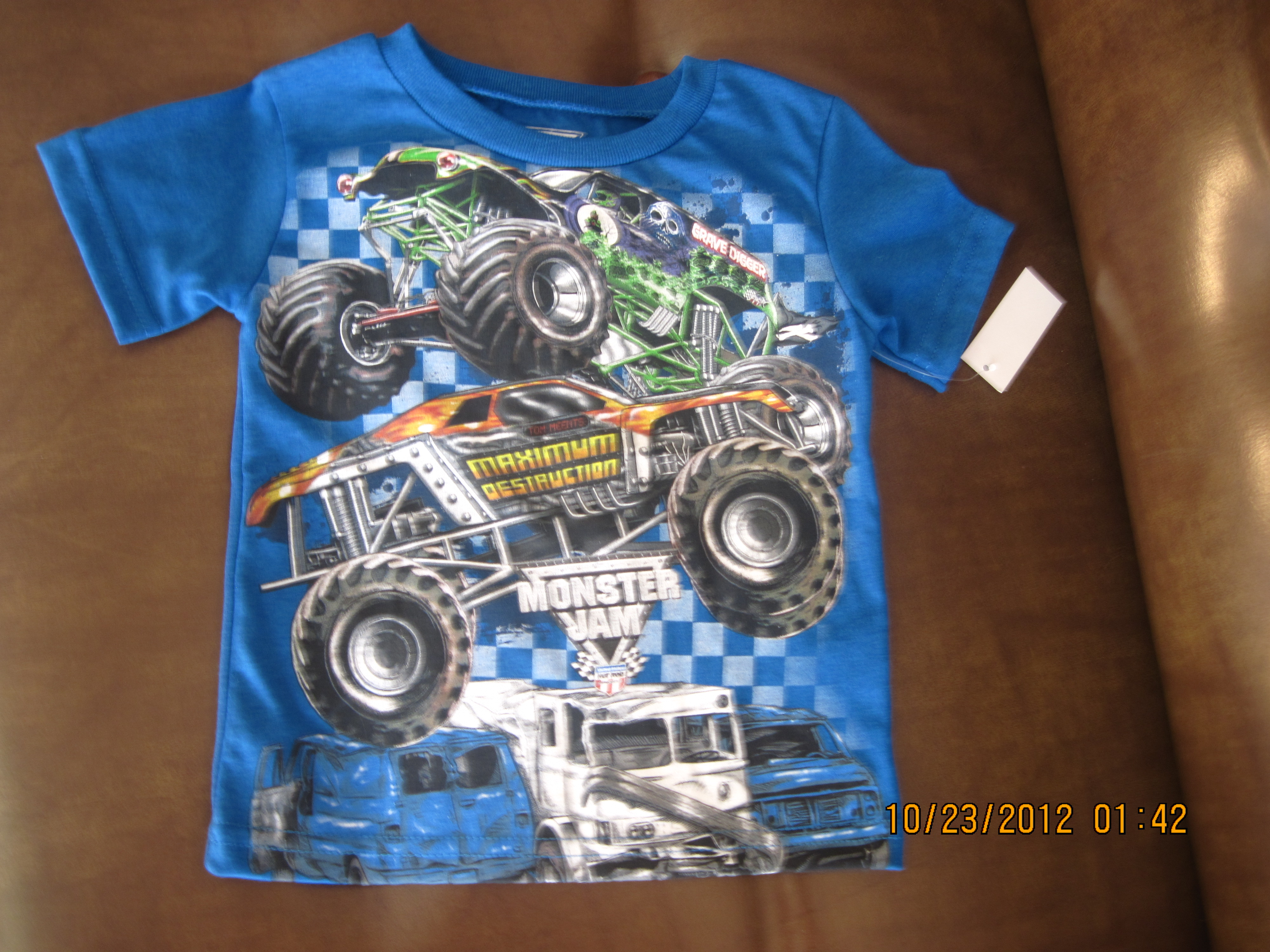 MonsterJam Sz 2T Trucks on Front Blue Shirt